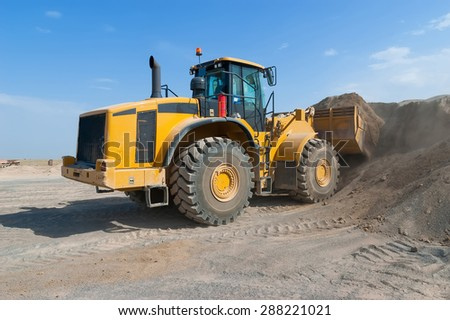 Wheel loader excavator - stock photo