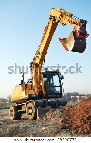 wheel loader excavator machine loading doing earthmoving work at sand quarry