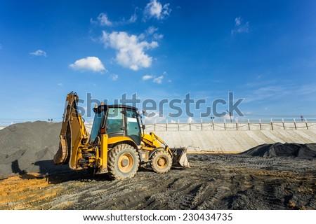 Wheel loader excavator machine working in construction site  - stock photo