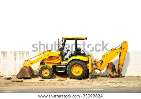 Wheel loader machine  on the road - stock photo