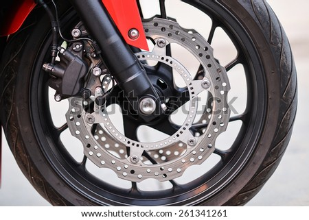 Wheel of a motorcycle - stock photo