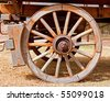 Wheel of a wooden wagon with brake - stock photo