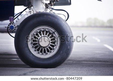 wheel of airplane - stock photo