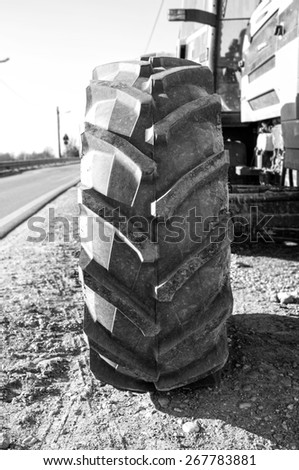 Wheel of an agricultural tractor, detail. Black and white image - stock photo
