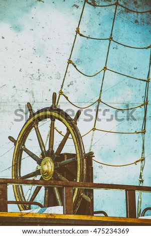 wheel of an old sailing ship in retro view