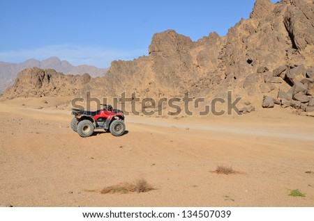 wheel of desert scooter arranged in a row - stock photo