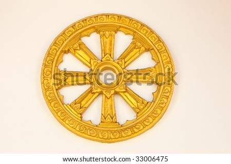 Wheel of Dhamma, symbol of Buddhism - stock photo