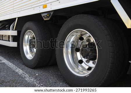 Wheel of large truck and trailers - stock photo