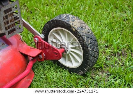 wheel of lawn mower gardening - stock photo