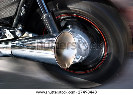Wheel of motorcycle on a open road - stock photo
