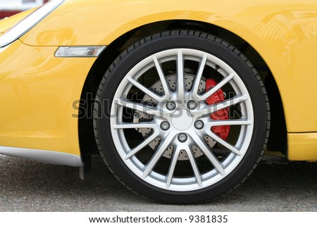 Wheel of new sports car 2 - stock photo