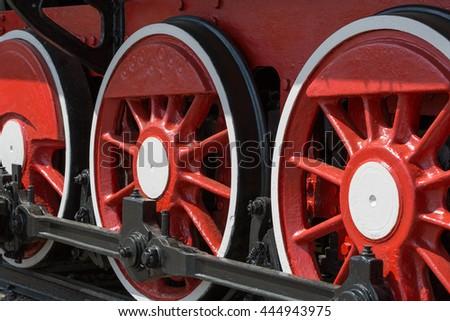 Wheel of old steam locomotive - stock photo