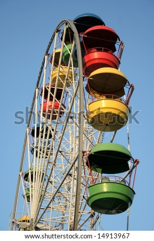 Wheel of review in Amusement park on blue sky background - stock photo