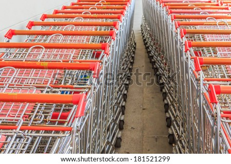 Wheel of Shopping carts on a parking lot . Detail of a shopping cart. - stock photo