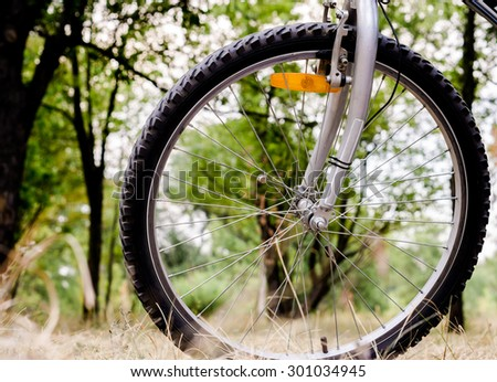 Wheel of sports mountain bike on nature background - stock photo
