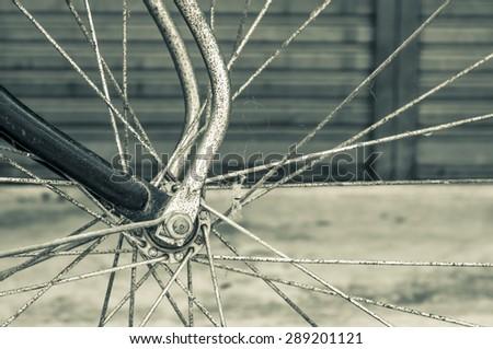 wheel of vintage bicycles on vintage sepia tone - stock photo