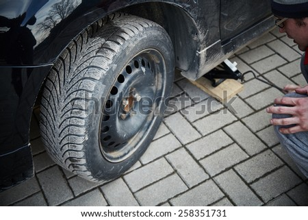 Wheel replacement. Jack. Spring and summer wheels. - stock photo