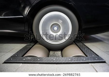 Wheel rolling on dynamo meter - stock photo