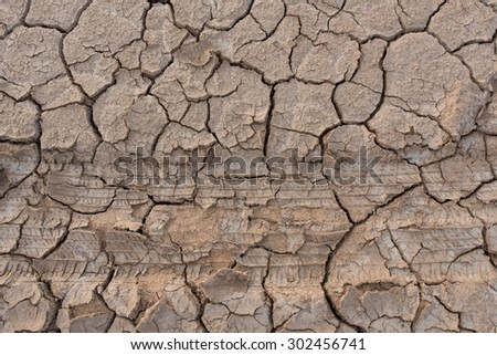 Wheel trace of a tyre on driedland - stock photo