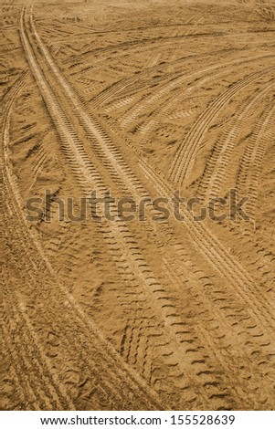 wheel track on sand 02 - stock photo