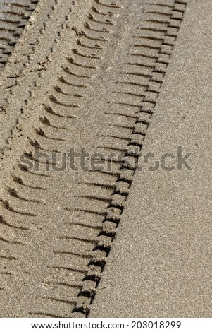Wheel Track on Sand, Vertical Closeup - stock photo