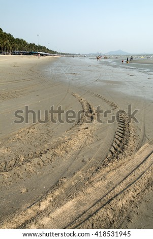 Wheel track on the beach,Car wheel tracks on the surface of the sea.