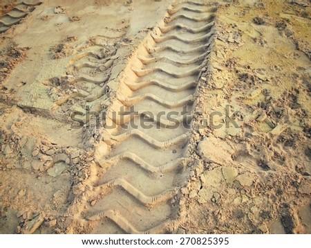 Wheel tracks on the soil. - stock photo