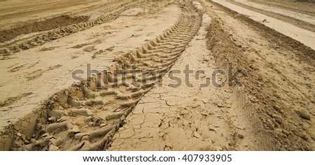 Wheel tracks on the soil.