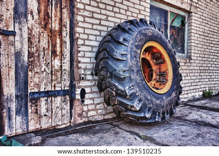 Wheel tractor for the wall. - stock photo