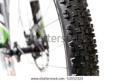 Wheel with tire of mountain bicycle isolated on white