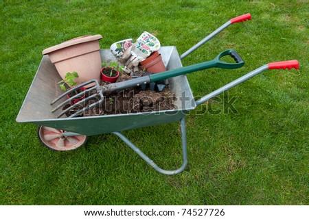 Wheelbarrow and garden tools - stock photo