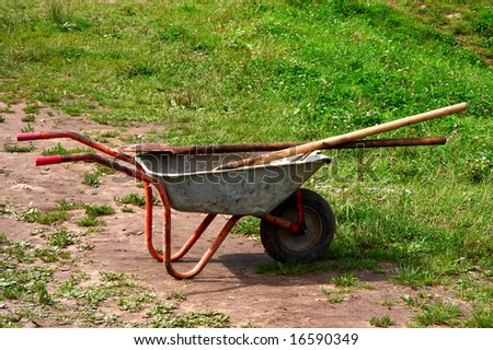 wheelbarrow at the green grass