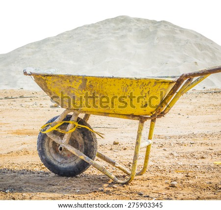 wheelbarrow for construction parked with sand background - stock photo