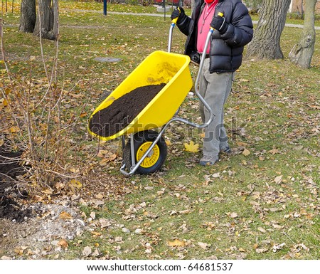 Wheelbarrow full of freshly dug earth - stock photo