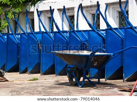 wheelbarrow in construction - stock photo