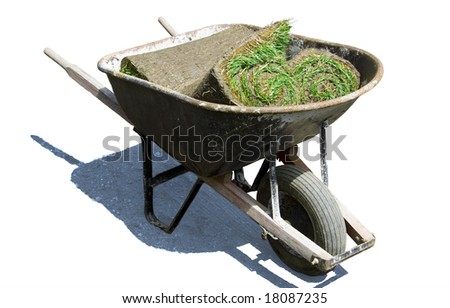 Wheelbarrow with rolls of sod - clipping paths included - stock photo