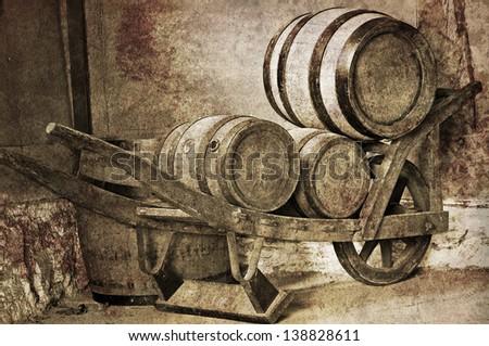 wheelbarrow with wine barrels vintage - stock photo