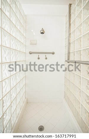 wheelchair accessible glass shower - stock photo