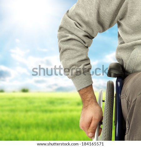 wheelchair and landscape  - stock photo