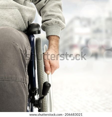 wheelchair and men in gray color  - stock photo