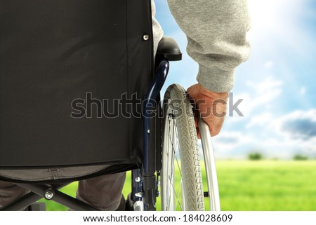 wheelchair and spring  - stock photo