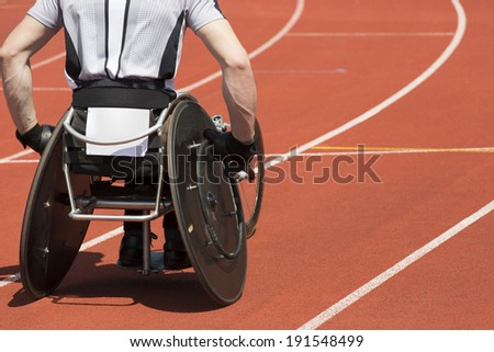 Wheelchair athlete concentrates  for his race to start. - stock photo