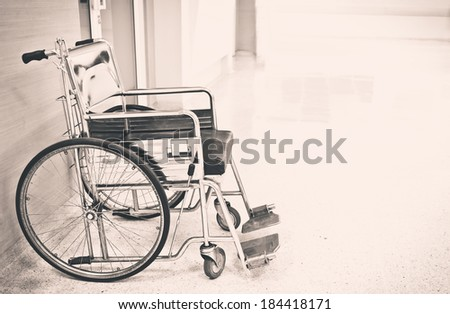 wheelchair for patient ,old film processed - stock photo