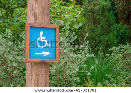 Wheelchair Handicap Sign in the park - Selective focus - stock photo