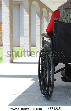 Wheelchair is parked in a hall - stock photo