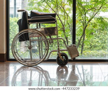 Wheelchair is prepared for service - stock photo