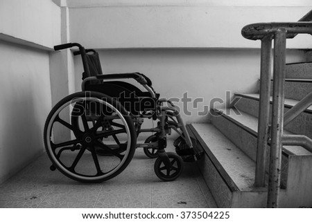 Wheelchair on stairway in black and white tone