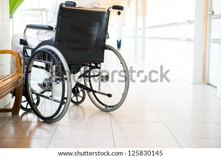 Wheelchair parked in hospital hallway. - stock photo