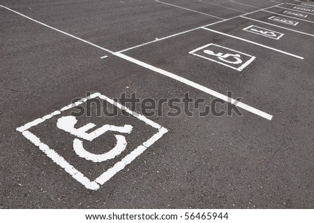 wheelchair parking symbole on asphalt road - stock photo