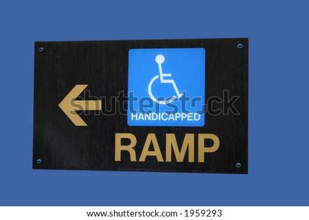 wheelchair ramp direction sign - stock photo